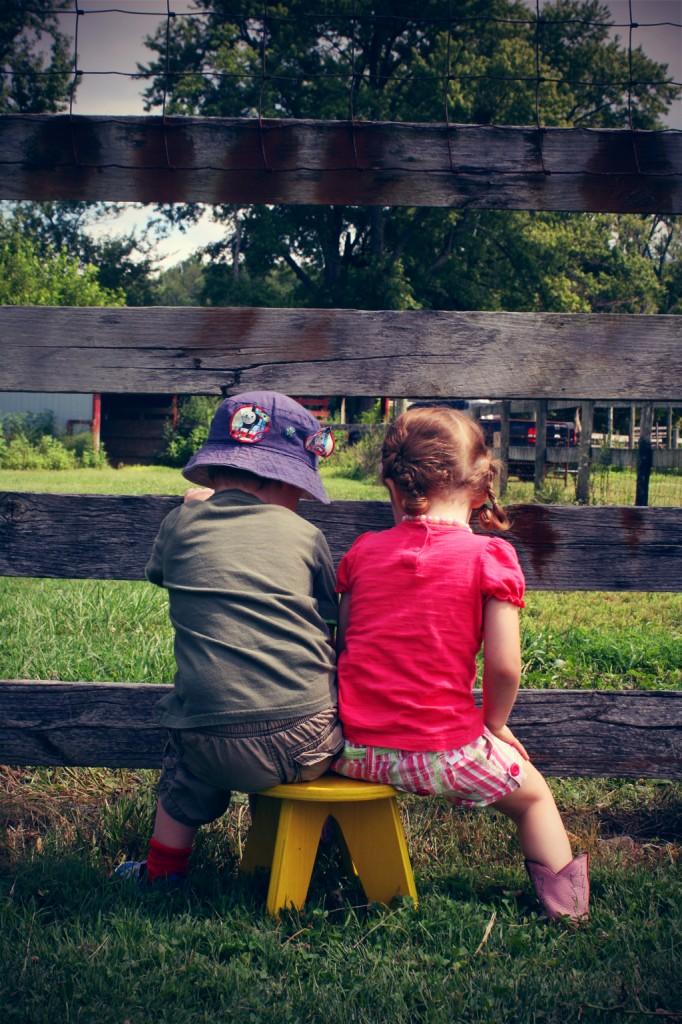 Children sitting on yellow stool